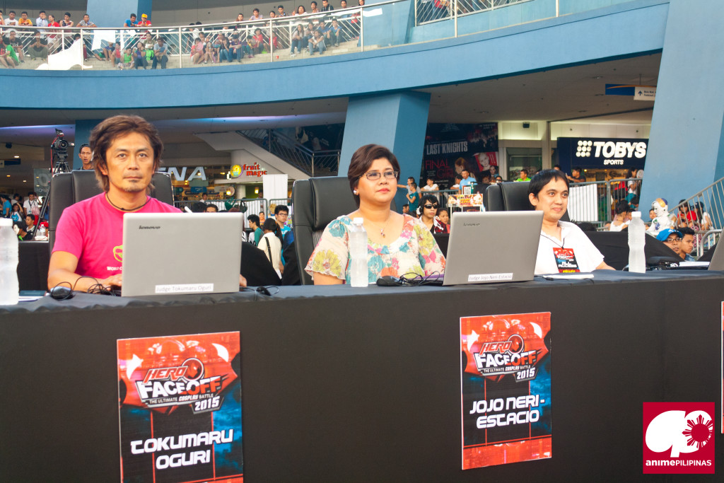 (From Left) World Cosplay Summit Founder and CEO Tokumaru Oguri, HEROtv Channel Head Jojo Estacio and illustrator Berlin Manalaysay, as judges of the HERO Face Off event. (Photo from JM Melegrito / Anime Pilipinas)