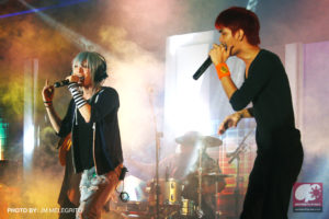 Adrian Sison, vocalist of Anisong cover band Moonspeak, performing with Popular Japanese cosplayer KANAME☆. (Photo from JM Melegrito / Anime Pilipinas)